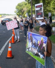 Protesters demonstrate outside Monmouth Park on Haskell Day