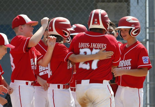 Donovan Louis Jacques (27) of Holbrook celebrates with teammates after hitting a home run against Bordentown during 2019 Little League Baseball Section 3 Tournament Championship. Toms River, NJ. Saturday, July 20, 2019. Noah K. Murray-Correspondent/Asbury Park Press