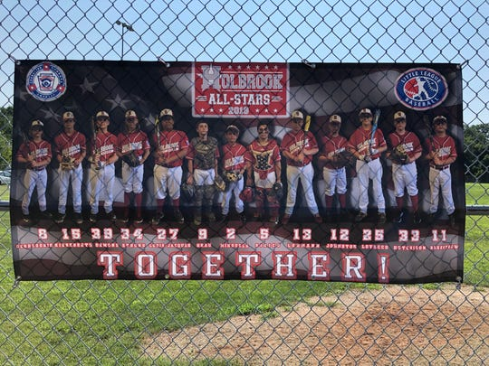 A poster showing the 2019 Holbrook 12-year-old All-Stars hangs on the fence before the Section 3 Championship game versus Bordentown on July 20 at Toms River East Little League