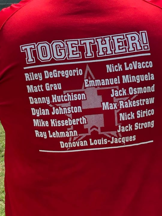 A fan of the Holbrook 12-year-old All-Stars wears a t-shirt showing the members of the team on July 20 at Toms River East Little League. Holbrook defeated Bordentown, 6-4, in the Section 3 Championship game.