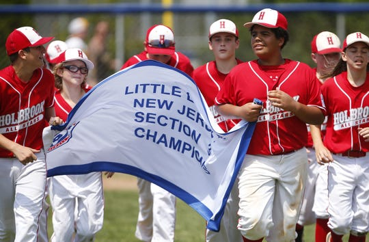 Holbrok Celebrates with banner after defeating Bordentown 2019 Little League Baseball Section 3 Tournament Championship. Toms River, NJ. Saturday, July 20, 2019. Noah K. Murray-Correspondent/Asbury Park Press