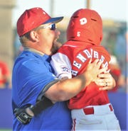 Abilene Dixie's Brady Henderson gets a hug from a manager Scott Henderson after getting a walkoff hit in the seventh inning to lift his team to a 13-12 victory over Corpus Christi National in the Little League Division opener at the Texas West State Little League baseball tournament Friday at Kirby Park. Henderson's hit capped a three-run inning, all with two outs.