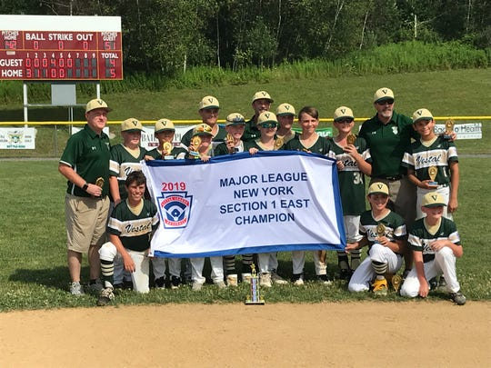 Vestal's players and coaches pose with their championship banner after beating Baldwinsville, 5-4 Saturday to win Section 1 East Little League title at Ted Testa Park in Cortland.