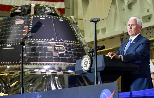 Standing next to the Orion capsule, Vice President Mike Pence addresses the crowd on the 50th anniversary of the Apollo 11 moon landing Saturday, July 20, 2019, in the Neil Armstrong Operations and Checkout Building at Kennedy Space Center