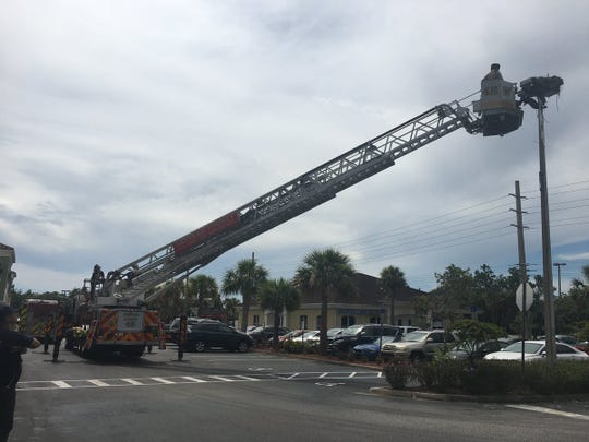 Fire fighters rescued an entangled osprey in Viera on Saturday July 20, 2019.