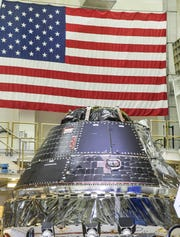 An Orion capsule sits in the high bay at the Operatons and Checkout Building on the 50th anniversary of the Apollo 11 moon landing Saturday, July 20, 2019.