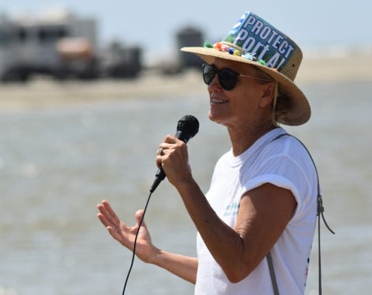 Tammy King, a member of the Port Aransas Conservancy, addresses those gathered a July 20, 2019 protest against the Port of Corpus Christi's plans for Harbor Island and other industrial growth in the area.