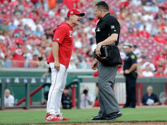 Cincinnati Reds manager David Bell (25) argues with home plate umpire Carlos Torres (3) after Cincinnati Reds third baseman Eugenio Suarez (7) was ejected between the first and second innings of an MLB baseball game against the St. Louis Cardinals, Friday, July 19, 2019, at Great American Ball Park in Cincinnati. Suarez was also ejected.