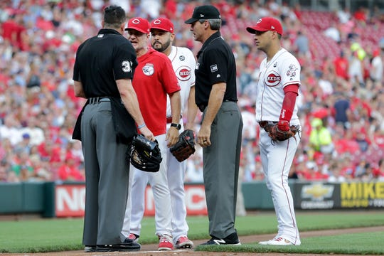 Cincinnati Reds Manager David Bell argues with home plate umpire Carlos Torres after third baseman Eugenio Suarez was ejected between the first and second innings against the St. Louis Cardinals in their MLB baseball game on Friday, July 19, 2019, at Great American Ball Park in Cincinnati.