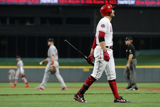 Cincinnati Reds first baseman Joey Votto (19) reacts recording the final out of the game with the bases loaded in the ninth inning of an MLB baseball game against the St. Louis Cardinals, Friday, July 19, 2019, at Great American Ball Park in Cincinnati.