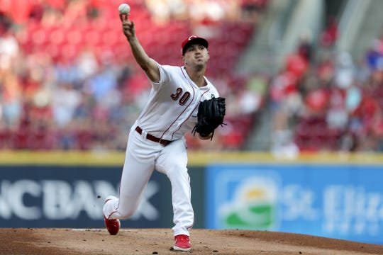Cincinnati Reds starting pitcher Tyler Mahle delivers in the first inning against the St. Louis Cardinals in their MLB baseball game on Friday, July 19, 2019, at Great American Ball Park in Cincinnati.