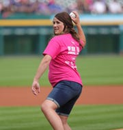 Cancer survivor Katie Nihem throws out the first pitch before Pink out the Park night, as the Detroit Tigers played the Toronto Blue Jays, Friday, July 19, 2019 at Comerica Park.