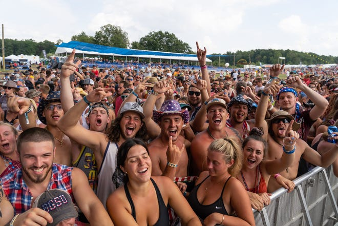 Crowds dance to music playing while waiting for the next performance during the Faster Horses festival on Friday, July 19, 2019 at Michigan International Speedway in Brooklyn.