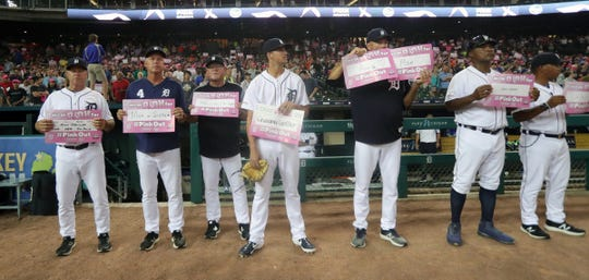 The Detroit Tigers stand for Pink out the Park night during the game against the Toronto Blue Jays, Friday, July 19, 2019 at Comerica Park.