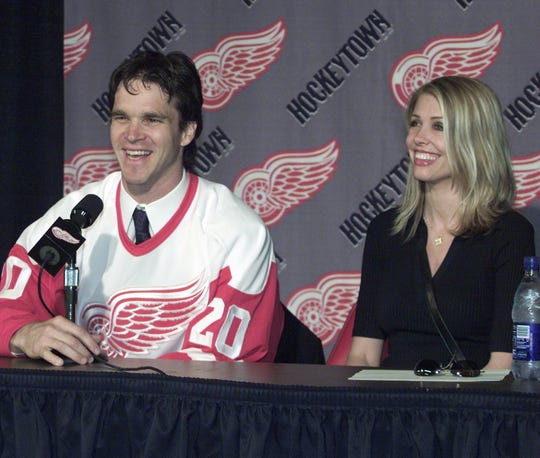 Red Wings forward Luc Robitaille and his wife, Stacia, right, answer questions during his introductory news conference at Joe Louis Arena on Thursday July 5, 2001.