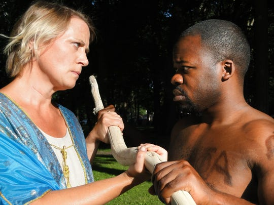 "Erika Hoveland as Prospero and Jarvis Pitts as Caliban in Shakespeare Royal Oak's staging of ""The Tempest."""