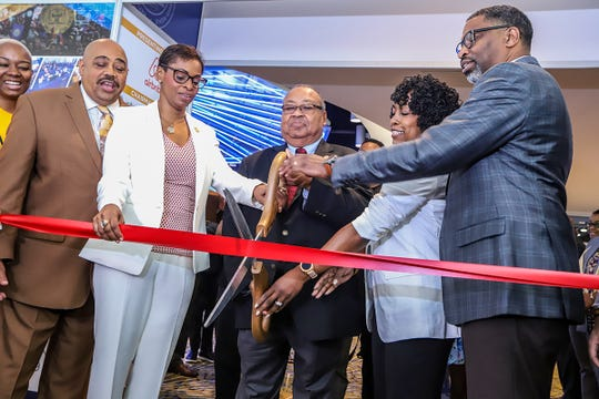 National Association for the Advancement of Colored People (NAACP) senior leadership Mike Turner, Karen Boykin-Towns, Leon Russell, and Derrick Johnson gather at the entrance to cut the ribbon officially opening the NAACP's 110th National Convention at Cobo Center in Detroit on Saturday, July 20, 2019.