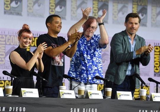 "Maisie Williams, from left, Jacob Anderson, Liam Cunningham and Nikolaj Coster-Waldau clap at the conclusion of the ""Game of Thrones"" panel on day two of Comic-Con International on Friday, July 19, 2019, in San Diego."
