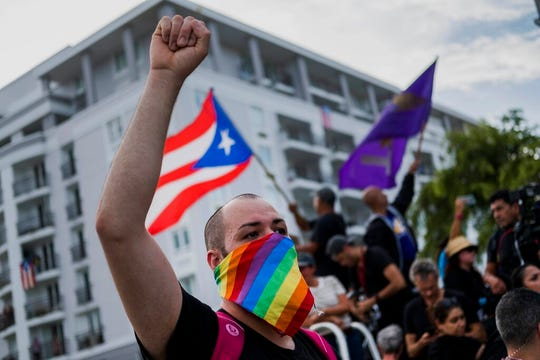 Demonstrators gather to protest against governor Ricardo Rossello, in San Juan, Puerto Rico, Friday, July 19, 2019.