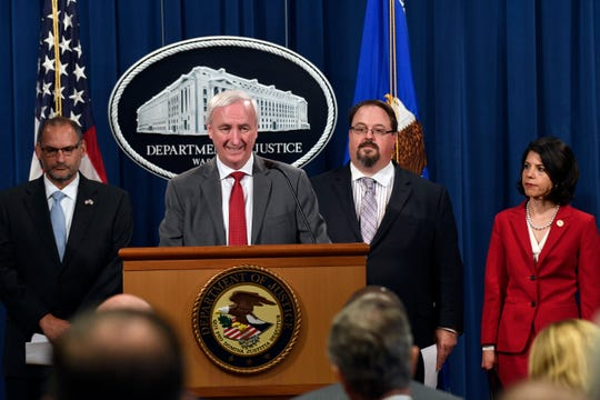 Deputy Attorney General Jeffrey Rosen, second from left, speaks during a news conference at the Justice Department in Washington, Friday, July 19, 2019, on developments in the implementation of the First Step Act. He is joined by, from left, acting Director of the Bureau of Prisons Hugh Hurwitz, Director of the National Institute of Justice David Muhlhausen and Associate Deputy Attorney General Toni Bacon.
