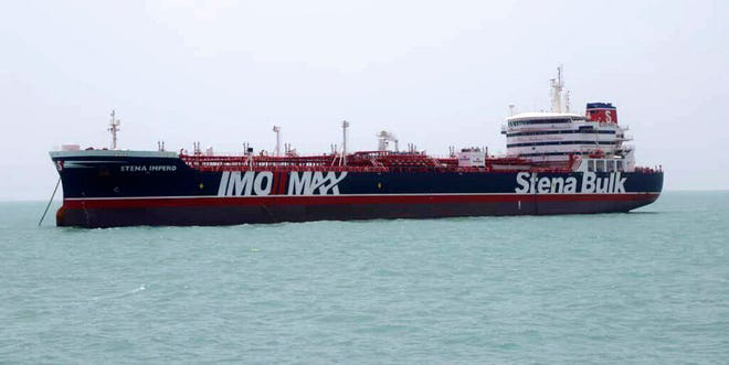 "A British-flagged oil tanker Stena Impero which was seized by the Iran's Revolutionary Guard on Friday is photographed in the Iranian port of Bandar Abbas, Saturday, July 20, 2019. The chairman of Britain's House of Commons Foreign Affairs Committee says military action to free the oil tanker seized by Iran would not be a good choice. Tom Tugendhat said Saturday it would be ""extremely unwise"" to seek a military solution to the escalating crisis, especially because the vessel has apparently been taken to a well-protected port."