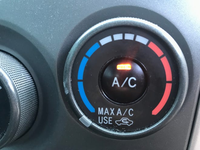 A car's air conditioner control knob.