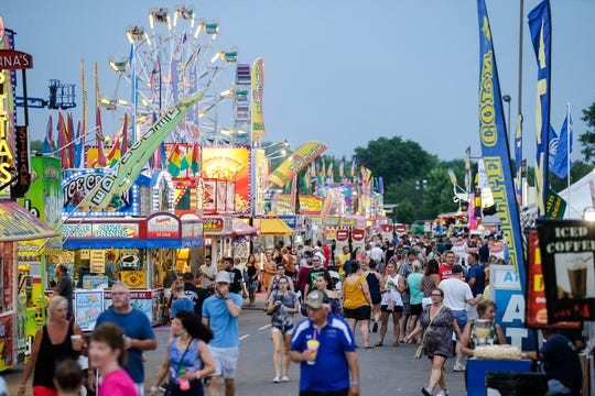 Hundreds of people brave the heat Friday, July 19, 2019 at the Fond du Lac County Fair at the fairgrounds in Fond du Lac, Wis. Doug Raflik/USA TODAY NETWORK-Wisconsin