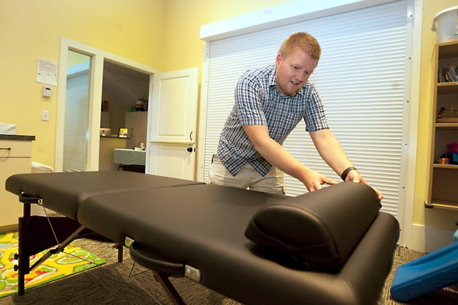 Nick Parrish, a volunteer clinical administrator with Mountain View Community Church, preps a medical bed for Christ Clinic on Friday evening. Christ Clinic, which sets up at two different churches in Fort Collins, accomplishes its mission by providing free primary care in an outpatient setting.