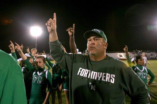 Fort Myers High School head football coach Sam Sirianni Jr. celebrates after winning the school's 600th win in 2010.