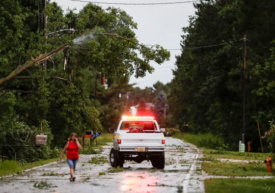 Two Rivers Fire Department responds to a fire in a tree on County Road O after high winds from a storm knocked it into a power-line Saturday, July 20, 2019, in Two Rivers, Wis.