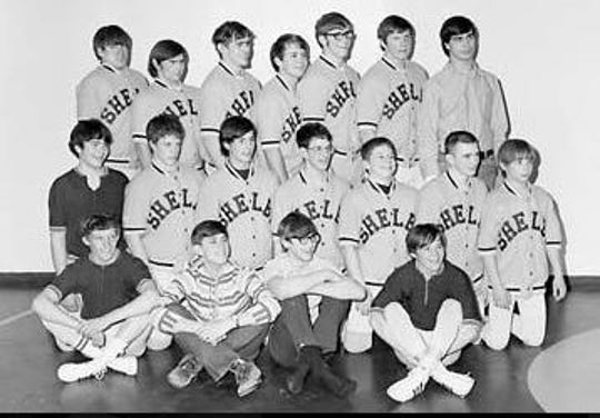 Les Benjamin, fifth from the left in the back row, was the first state champion for the Shelby wrestling team in the 1970s.