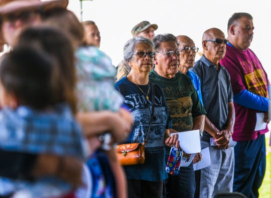 Original residents of Sumay village, their descendants and others attend a memorial Mass celebrated at the Sumay Cemetery, located on Naval Base Guam, on Saturday, July 20, 2019.