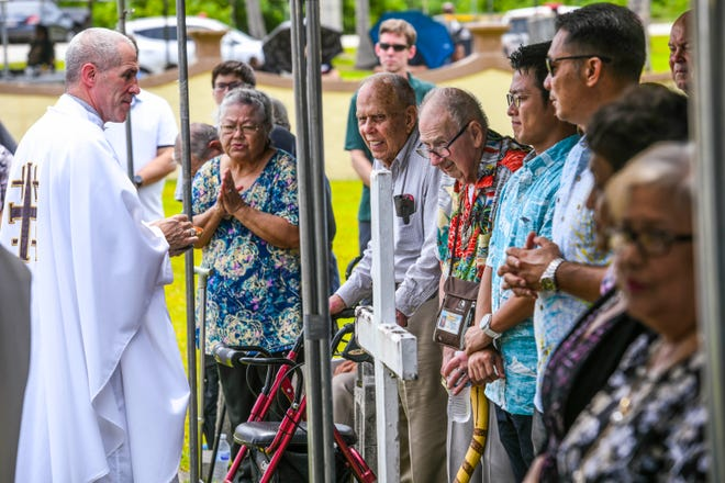 Original residents of Sumay village, their descendants and others attend a memorial Mass at the Sumay Cemetery, located on Naval Base Guam, in this July 20 file photo. Guam Republicans will sendletters to members of the Senate, urging them to pass a bill to that would finally allow payment of World War II reparations.