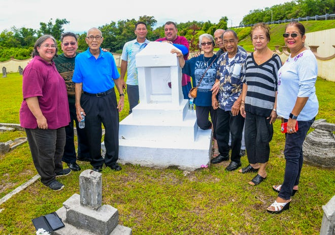 Descendants of Margarita Santiago Babauta gather at her gravesite after a memorial Mass celebrated at the Sumay Cemetery, located on Naval Base Guam, in this July 20 file photo.