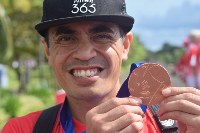 Derek Mandell took bronze at the Pacific Games July 20 with a time of 1:15:05 in the half marathon.