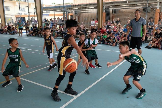 Guam Elite tops the Sinajana Rockers 20-18 at the Sinajana Community Center gym in this  July 20 file photo of the Sinajana 2019 Summer Sizzle Hoops Fest.