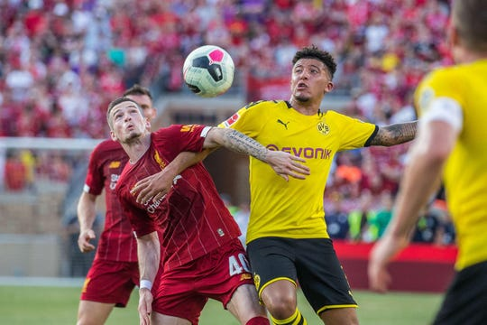 Liverpool midfielder Ryan Kent (40) and Borussia Dortmund midfielder Jadon Sancho (7) fight for possession of the ball in the first half of a preseason preparation soccer match at Notre Dame.