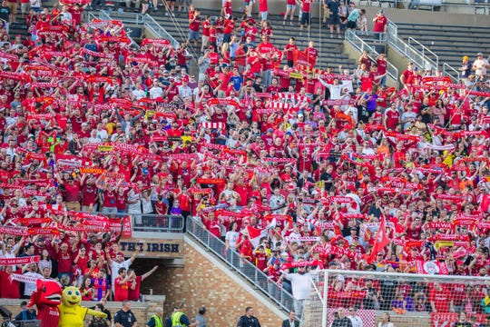 Liverpool fans hold up their scarves and sing you will never walk alone before the start of a pre-season preparation soccer match between the Liverpool and the Borussia Dortmund at Notre Dame.