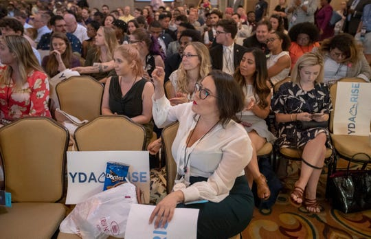 Audience members watch the national convention for the Young Democrats of America, held in Indianapolis, Friday, July 19, 2019.
