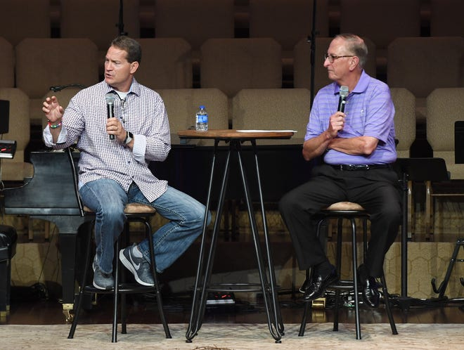 Former Auburn head football coach Gene Chizik joins Sam McElroy on stage at First Baptist Church Milan to talk to 16 different west Tennessee football teams, Friday, July 19.