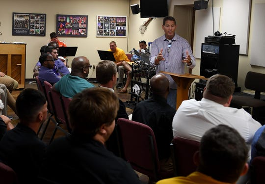 Former Auburn head football coach Gene Chizik talks to West Tennessee football coaches, Friday, July 19, 2019 at First Baptist Church Milan.