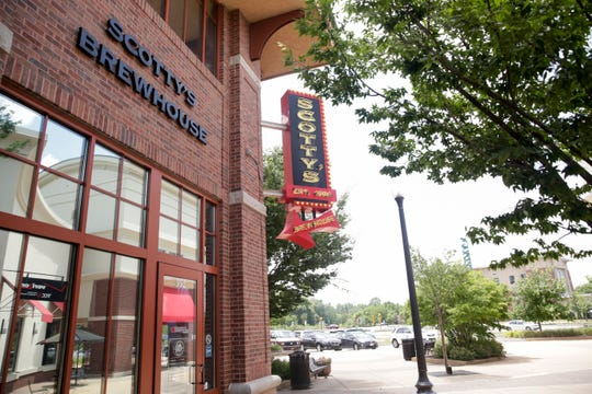 Signs posted inside Scotty's Brewhouse, 352 E State st., say all locations would cease operations on July 20, 2019, Saturday, July 20, 2019 in West Lafayette.
