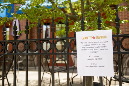 Hours after signs were posted announcing Scotty's Brewhouse, 352 E State st., abrupt closing, a sign from Lafayette Brewing Co. offering employment to Scotty's Brewhouse employees, Saturday, July 20, 2019 in West Lafayette.