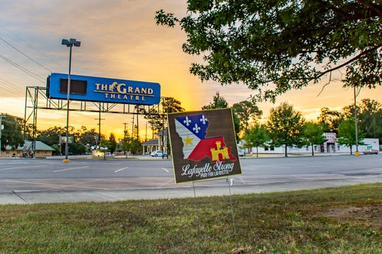 A Lafayette Strong sign stands outside the then-closed Grand 16 Theatre on Johnston Street in Lafayette following the tragic shooting in July 2015. Memories of the tragedy were recorded  during a History Harvest pop-up event at the Lafayette Farmers and Artisan Market at the Horse Farm. It is part of a research project led by University of Louisiana at Lafayette assistant professor of history Liz Skilton.
