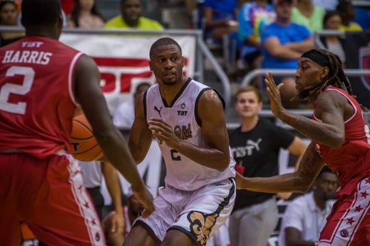 Former Ragin' Cajun basketball player Tyren Johnson dribbles the ball as Louisiana United plays Team Arkansas in 2019's The Basketball Tournament.