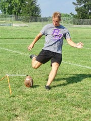 Bloom-Carroll's Cameron Shirkey practices kicking on Friday. He is ranked as one of the top high school kickers in the country.
