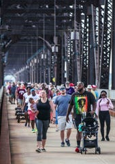 Hundreds of people came out to support a community walk at the Big Four Bridge Saturday morning in the response to racist graffiti that was painted last week on the public walking bridge. Hannah Drake organized Saturday's community walk after the graffiti was discovered July 10 on the Big Four Bridge.