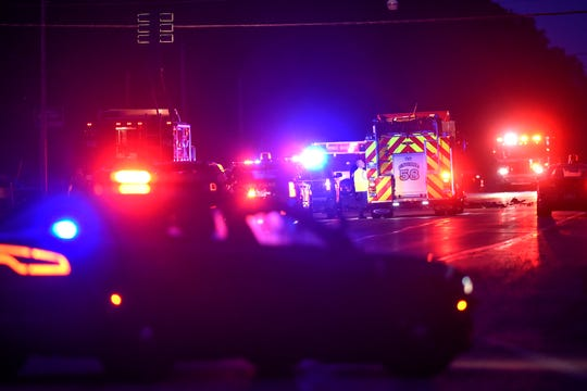 Emergency personnel at the scene of a multiple-vehicle crash on Old U.S. 127 near Cutler Road on Friday, July 19, 2019, in DeWitt.