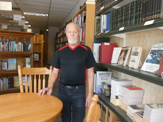 Carl Nelson is one of the owners of Books on Center, 150 W. Center St., whose front window was shattered by a gunshot in a shooting last weekend.