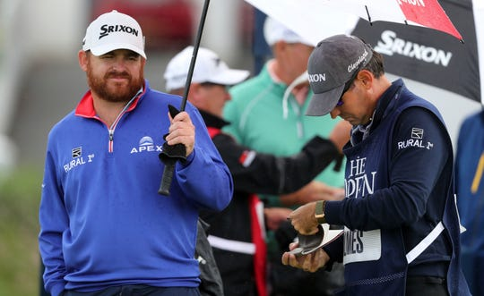 Co-leader J.B. Holmes will be in the final pairing with Shane Lowry during the third round of the British Open. The two will tee off at 9:50 a.m. CDT.